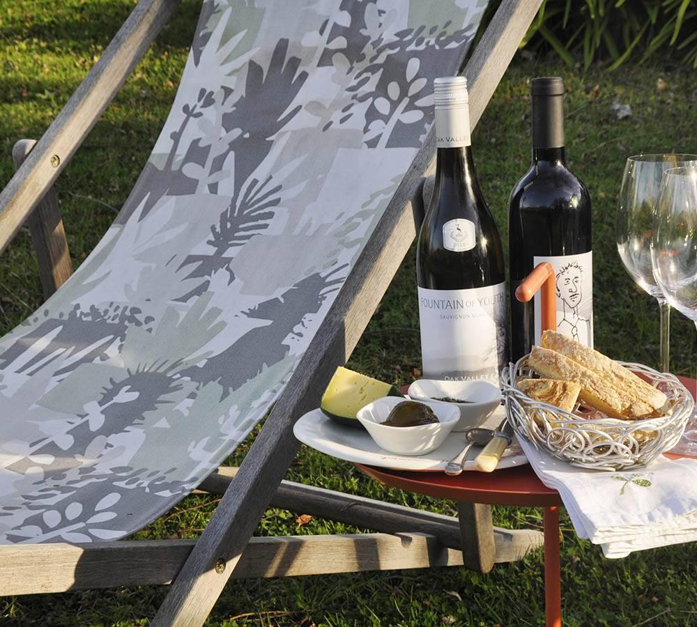 Unwinding in the garden, drinking wine from the Elgin region