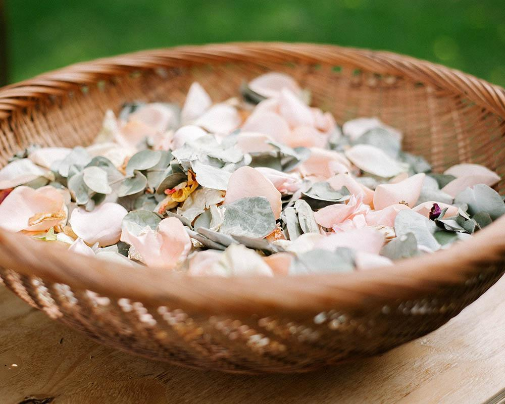 Bowl of rose petals as confetti